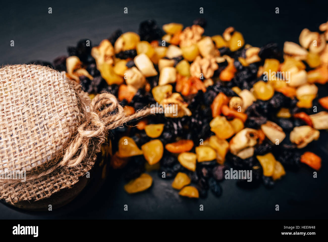 set vegetarian of dried fruit, candied fruit and nuts on a stone table - Stock Image