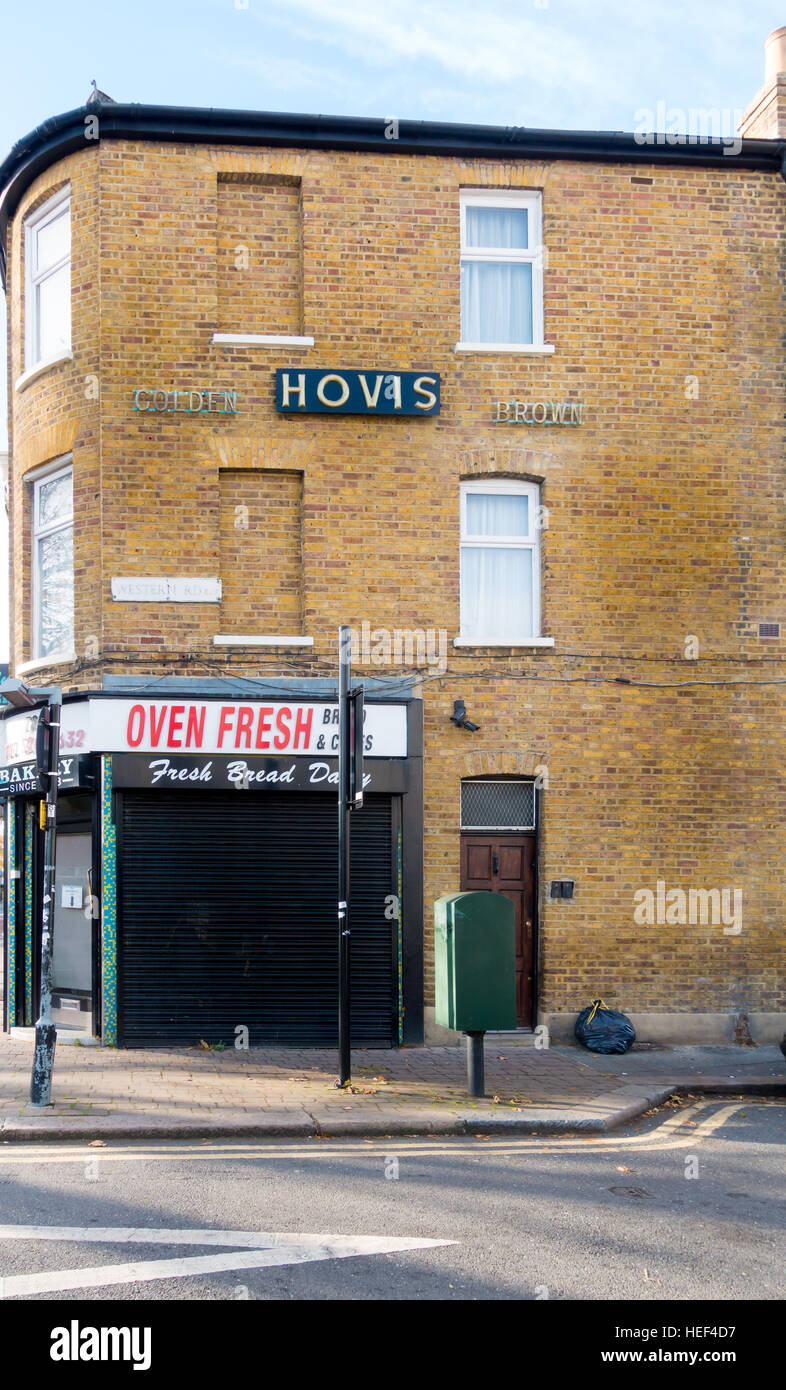A closed bakery with HOVIS sign in East London. - Stock Image