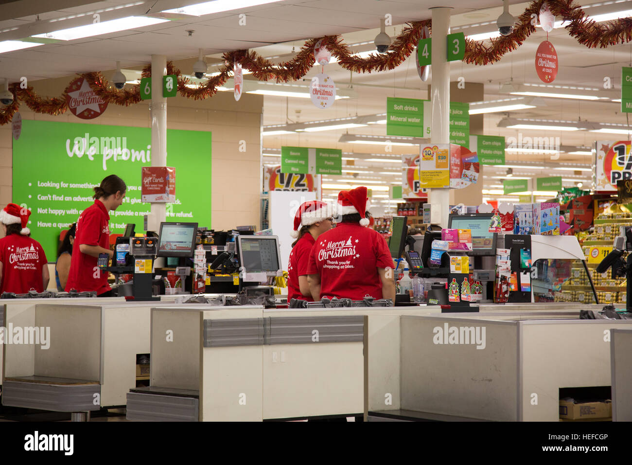 coles supermarket store in sydneyaustralia staff are wearing merry christmas clothes and hats - Coles Christmas Decorations