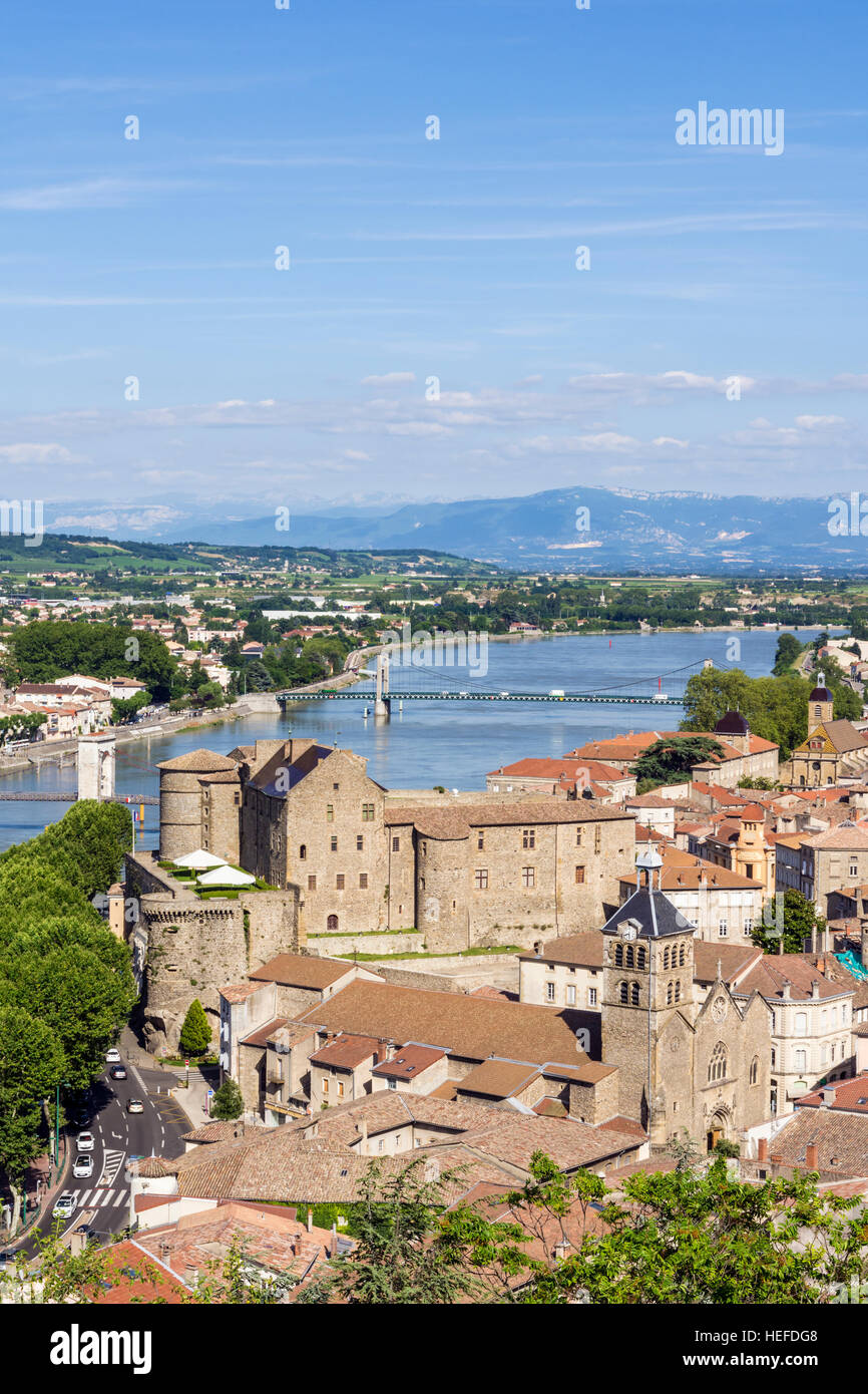 Views over the medieval town of Tournon-sur-Rhône, its Château and the Rhône River separating the - Stock Image