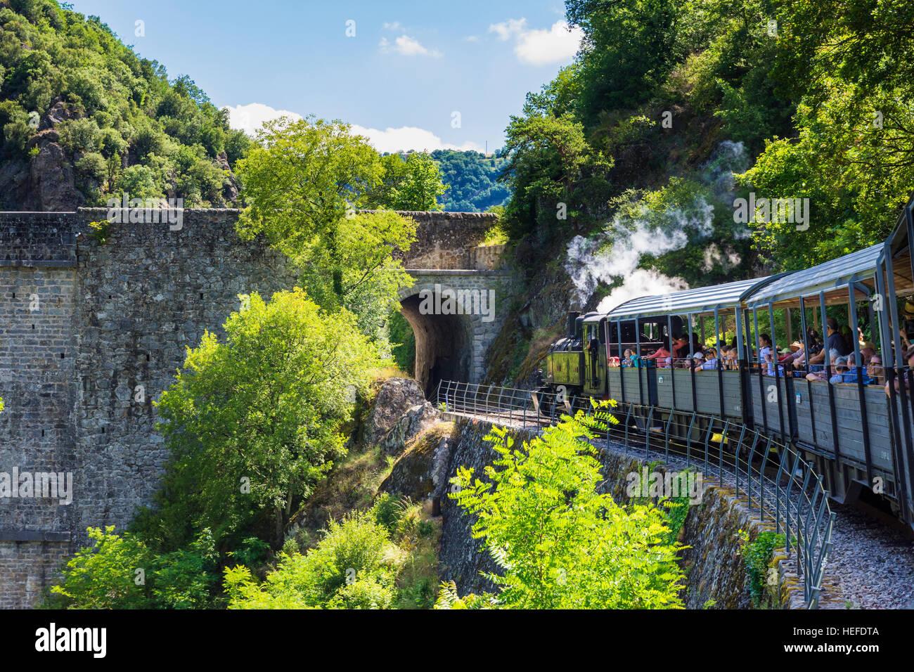 Train de l'Ardèche tourist railway through the tunnel of  the Pont des Etroits, Ardèche, France - Stock Image
