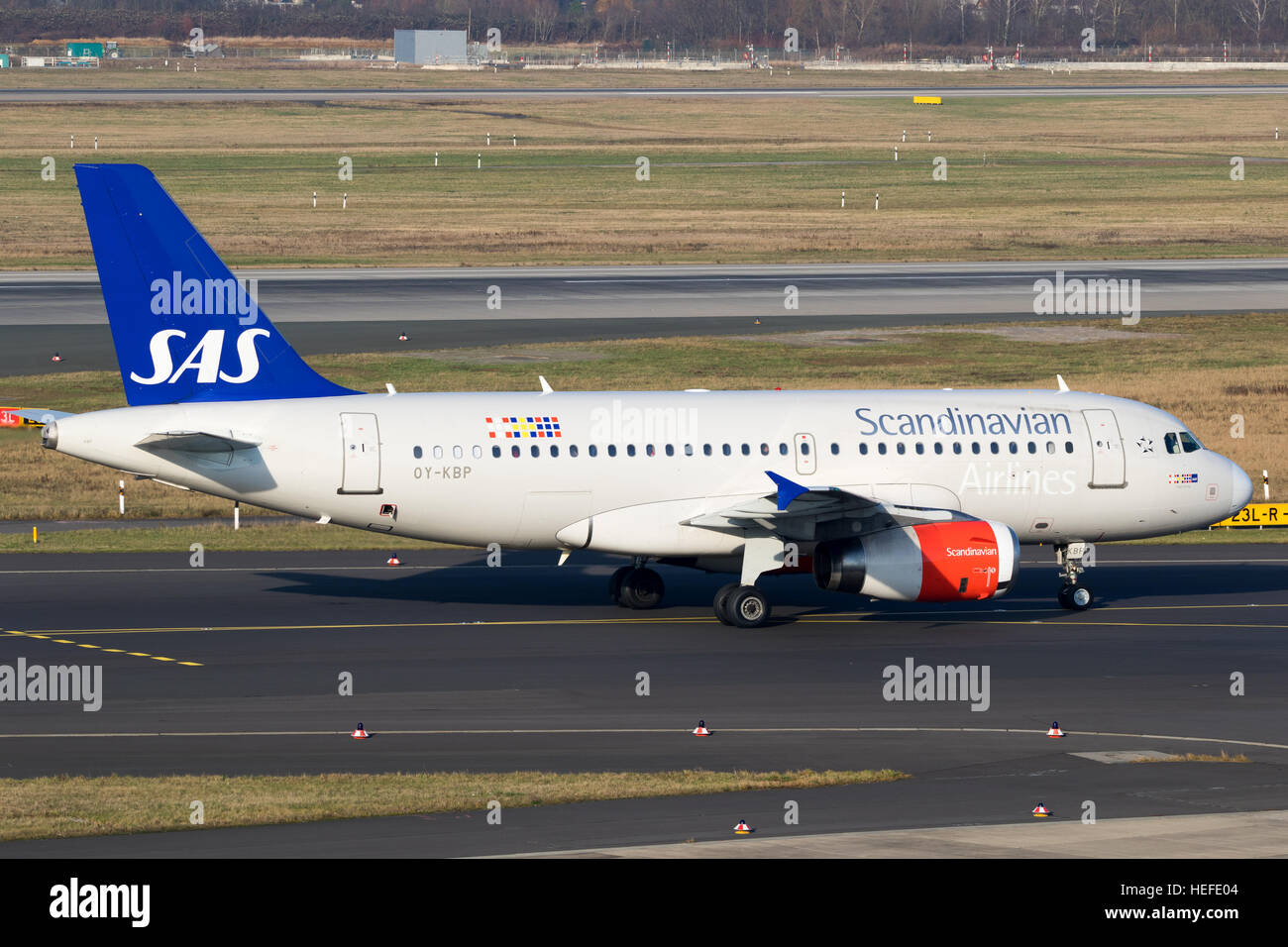 Airbus A319 from SAS Scandinavian Airlines taxiing before take off from Düsseldorf airport - Stock Image