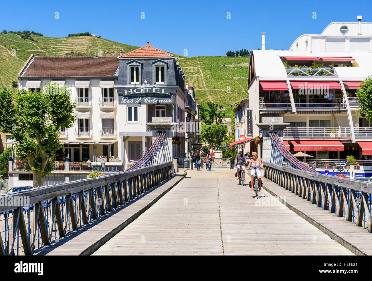 The Marc Seguin Bridge looking towards the town and vineyards of Tain-l'Hermitage, Drôme, Auvergne-Rhône - Stock Image