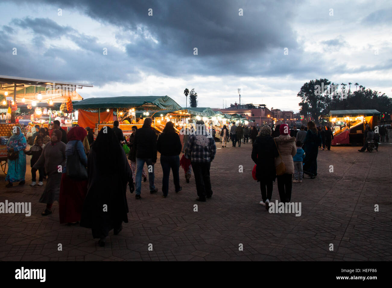 MARRAKESH, MOROCCO - DECEMBER 2016: People during the evening on the very busy main square of Marrakesh in Morocco Stock Photo