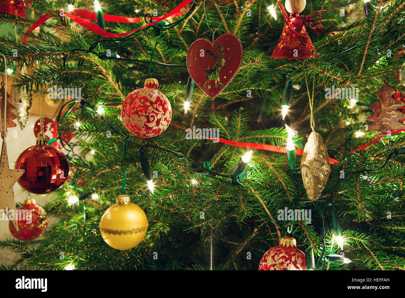 Christmas tree decorations with baubles - Stock Image
