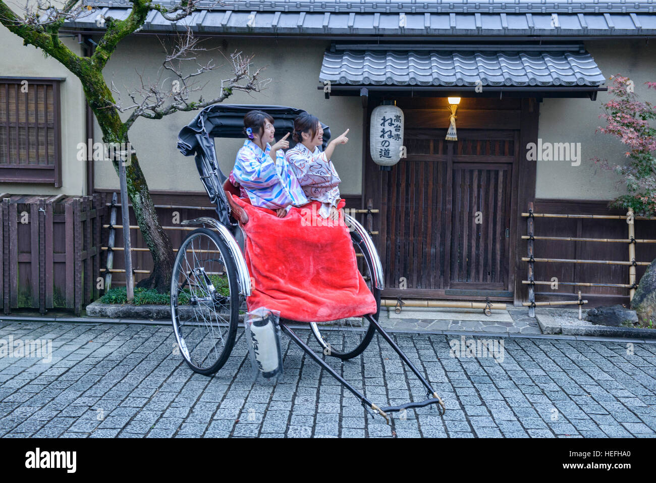 Sightseeing by jinrickshaw in Higashiyama, Kyoto, Japan - Stock Image