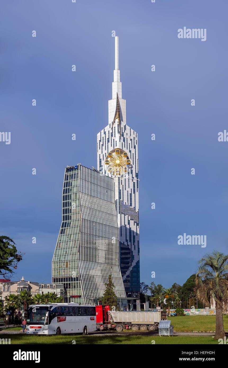 Technological University Tower with ferris wheel and Radisson Blu Hotel Batumi Georgia. - Stock Image