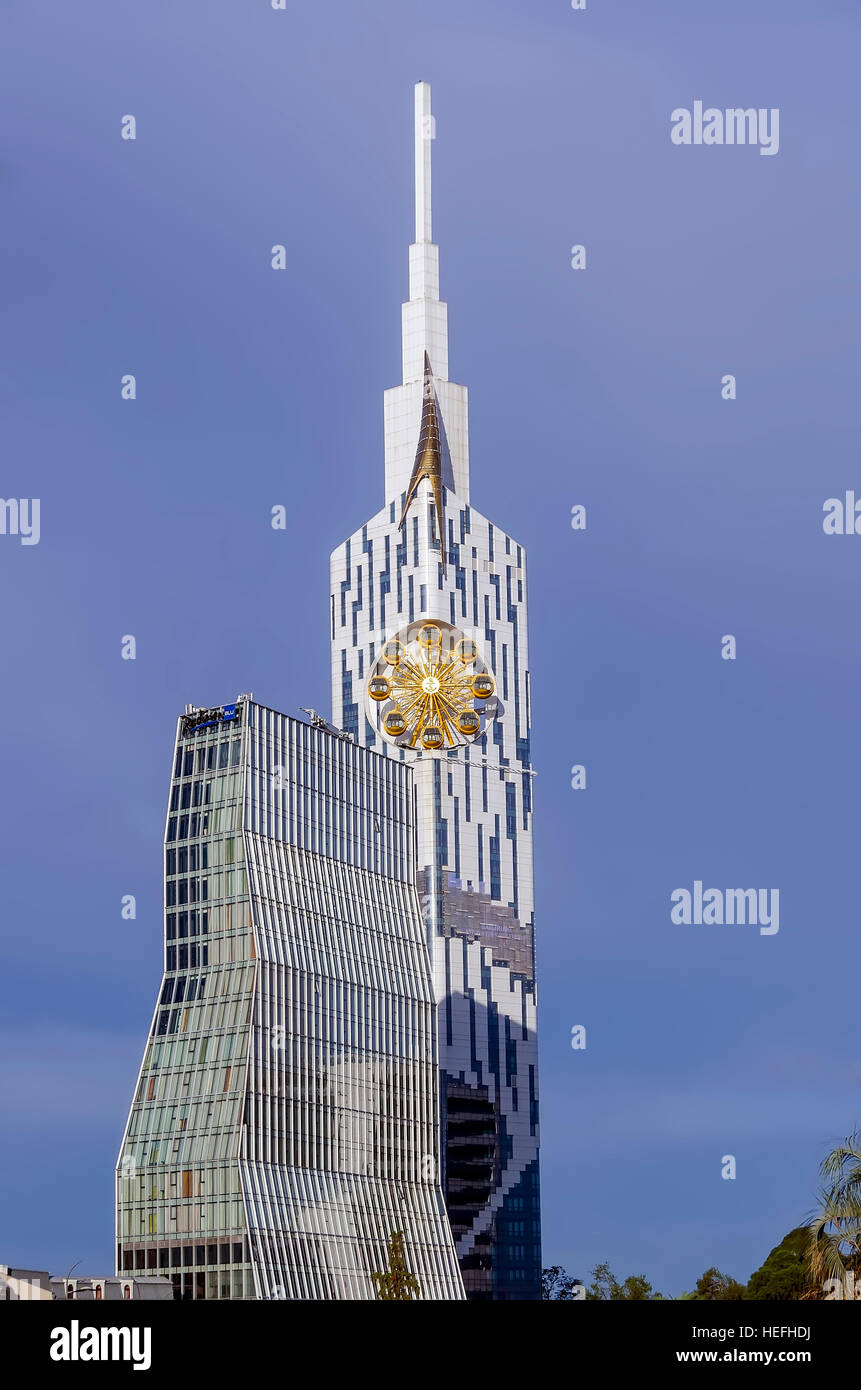 Technological University Tower with ferris wheel and Radisson Blu Hotel Batumi Georgia. - Stock Image
