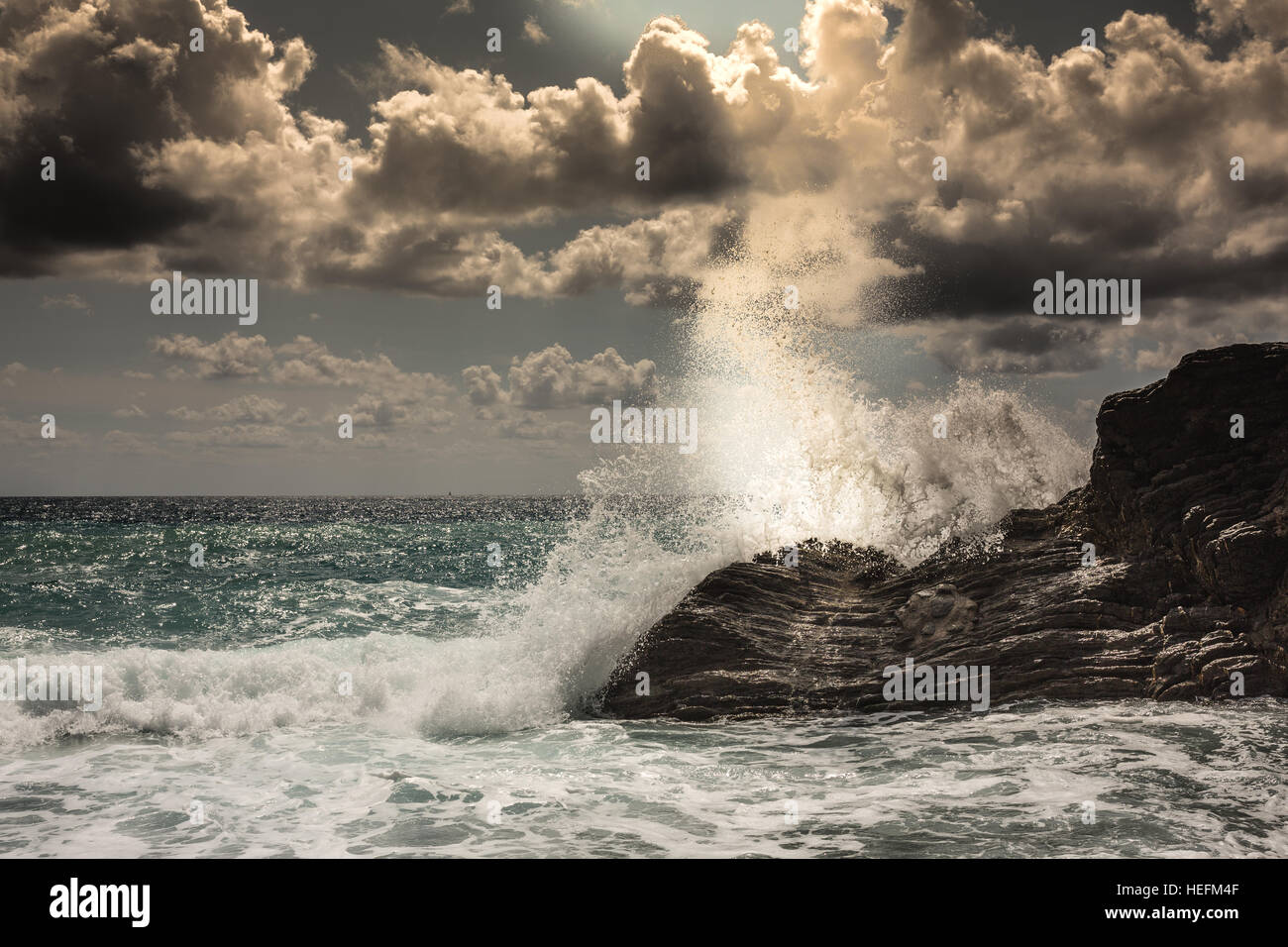 Crashing waves in Cinque Terre,Vernazza, Italy - Stock Image