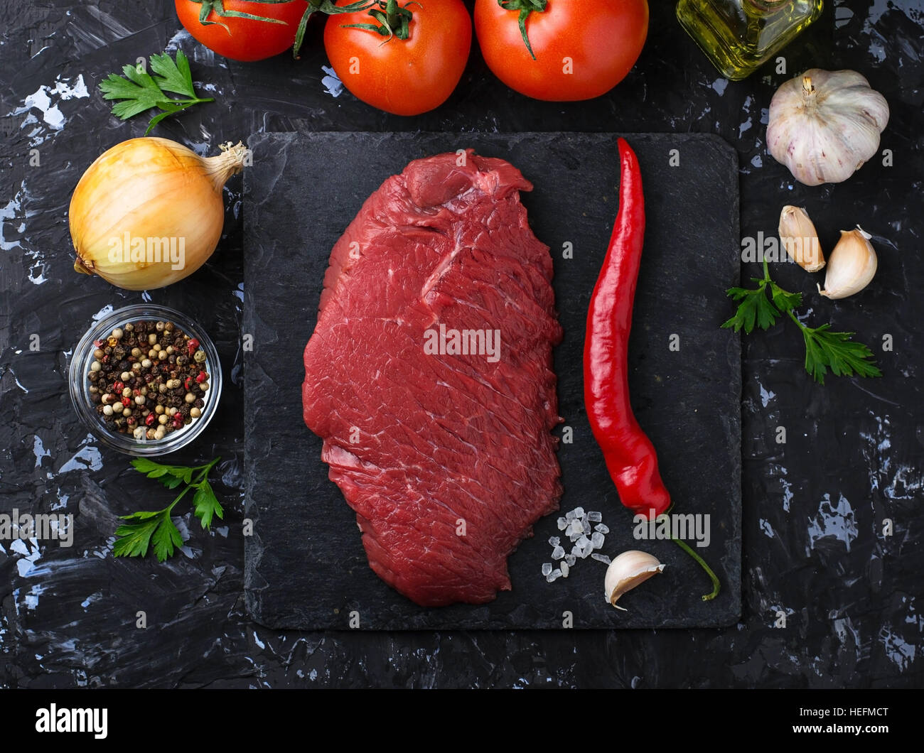 Raw fresh beef steak and vegetable. Selective focus Stock Photo