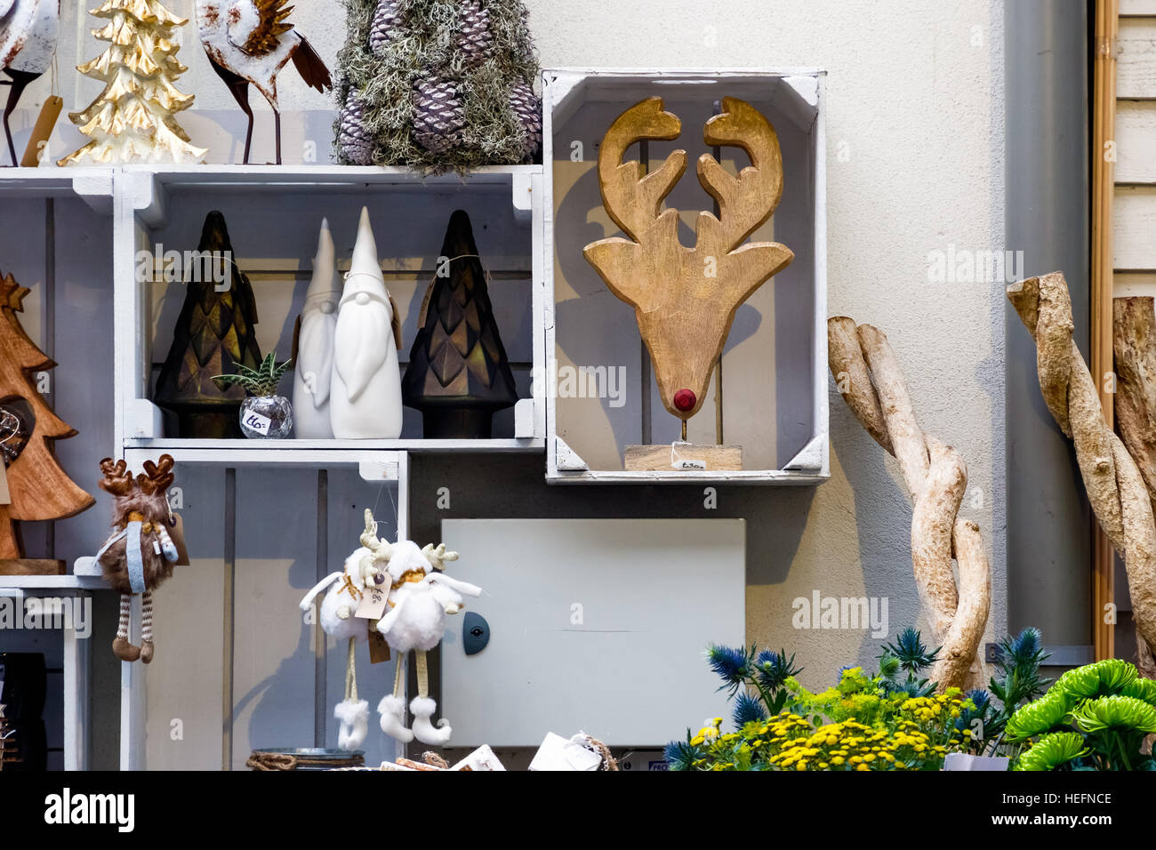 Christmas garden ornaments on display at Borough Market in London - Stock Image