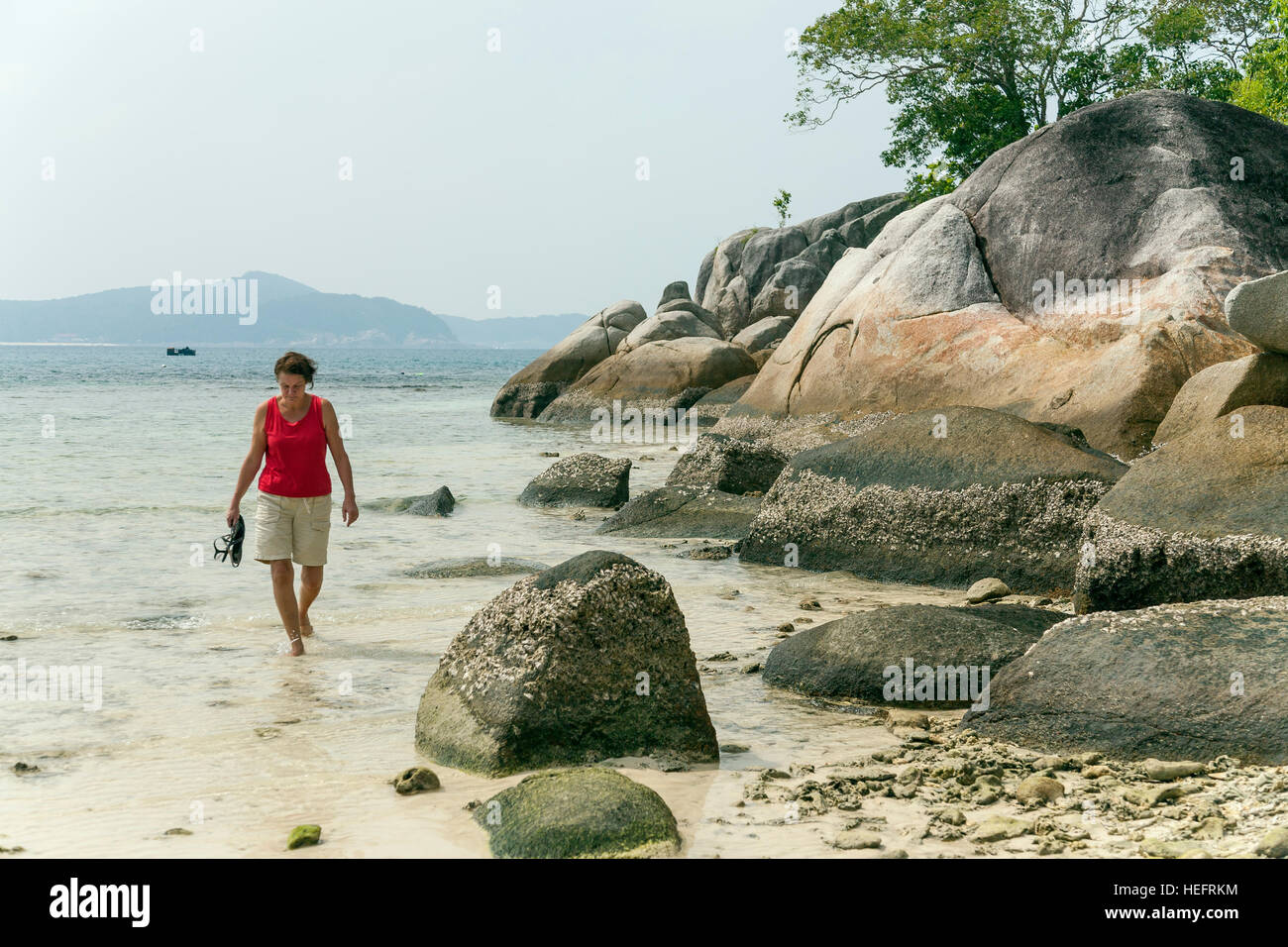 Walking on a tropical beach, Malaysia - Stock Image