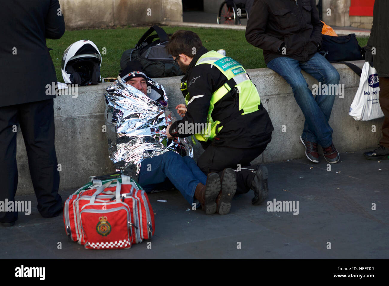 Hypothermia and elderly. London Ambulance Paramedic. Hypothermia blanket Medical assistance UK. Cold weather. Homeless - Stock Image