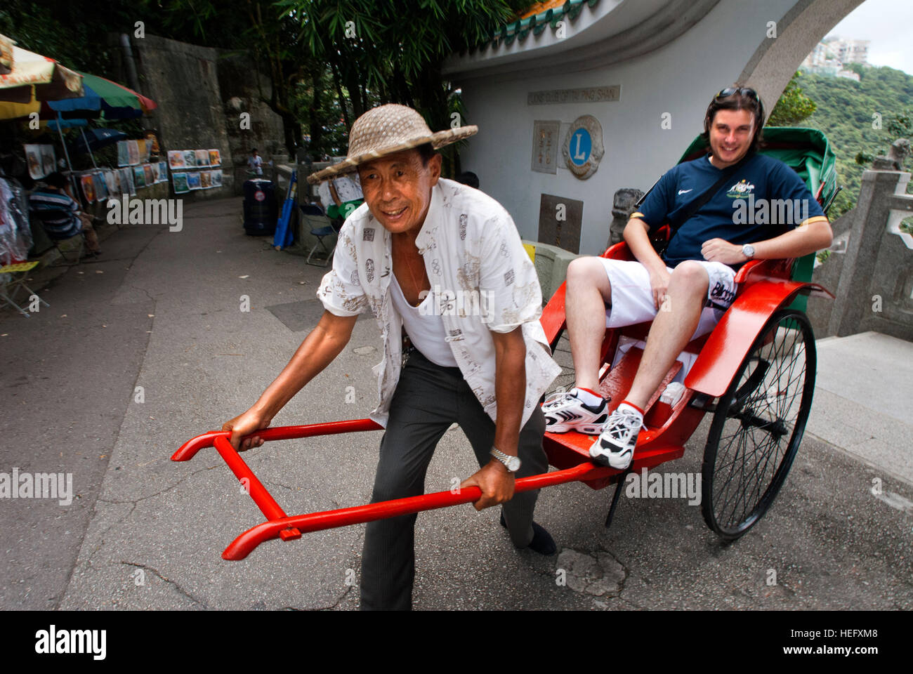 A tourists taken pictures inside of a old Rickshaw, Hong Kong, China. - Stock Image