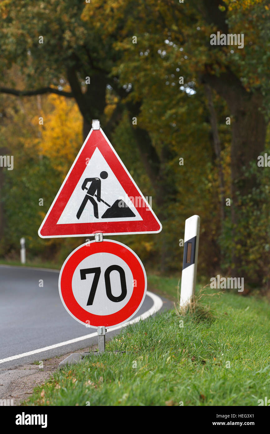 Road sign on curve, speed limit and construction work, Schleswig-Holstein, Germany - Stock Image