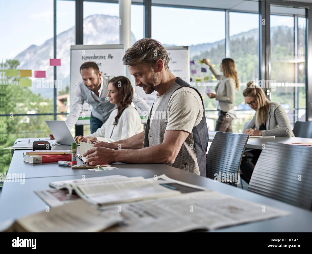 Creative teamwork, presentation, brainstorming, project work, workshop, training, seminar for executives, adult - Stock Image