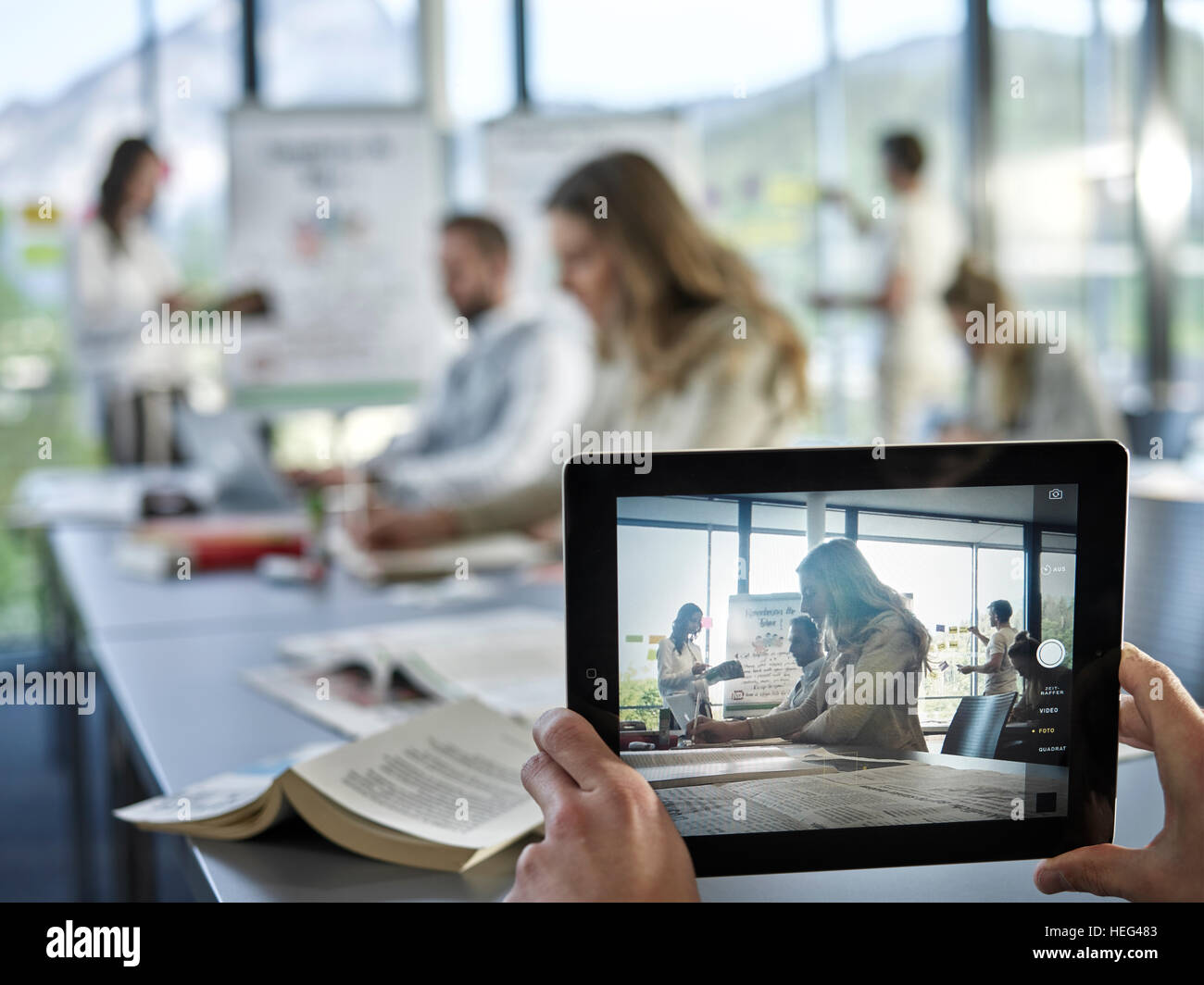 Photo with an iPad, Creative teamwork, presentation, brainstorming, project work, workshop, training, seminar for - Stock Image