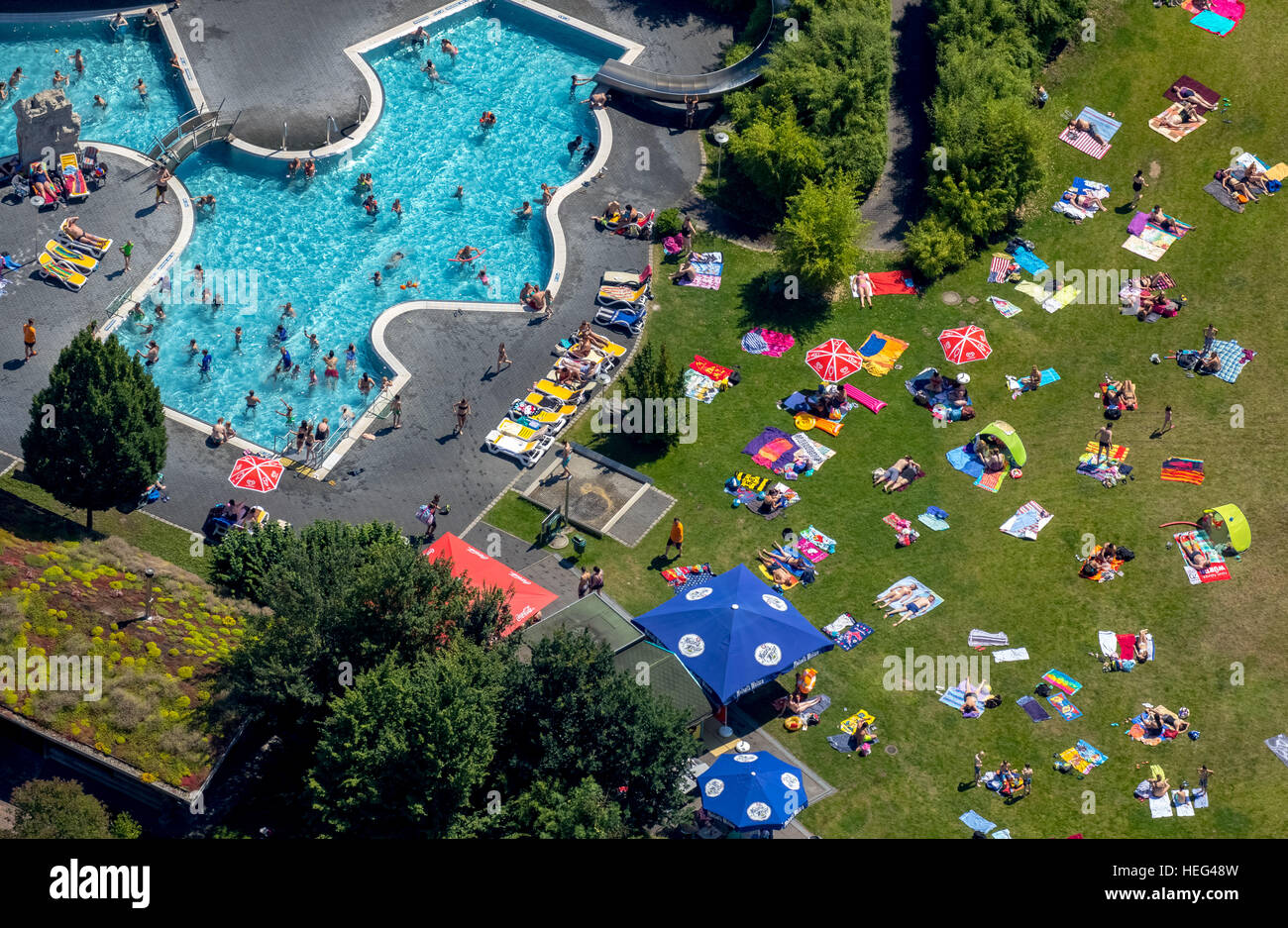 Aerial view, bathers at Atlantis outdoor pool, sunbathing lawn, Dorsten, Ruhr district, North Rhine-Westphalia, - Stock Image