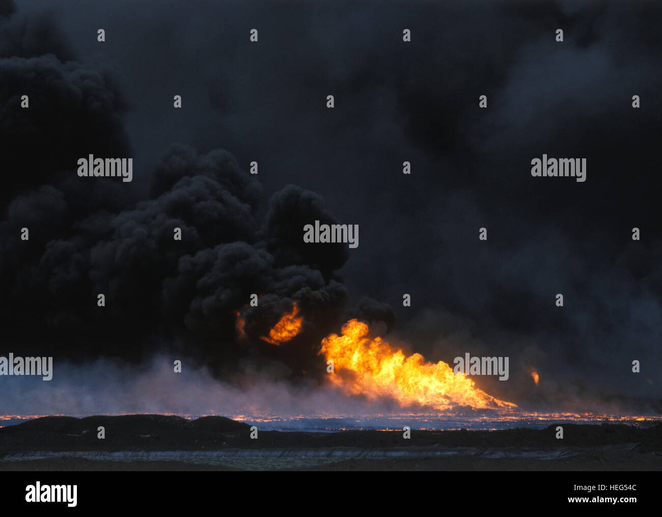 Burning oil fields at Al Burgan at the end of Gulf War. Kuwait - Stock Image