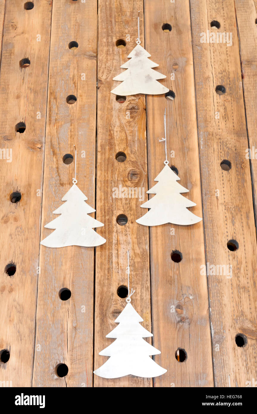 Christmas trees on a woodwork wall - Stock Image