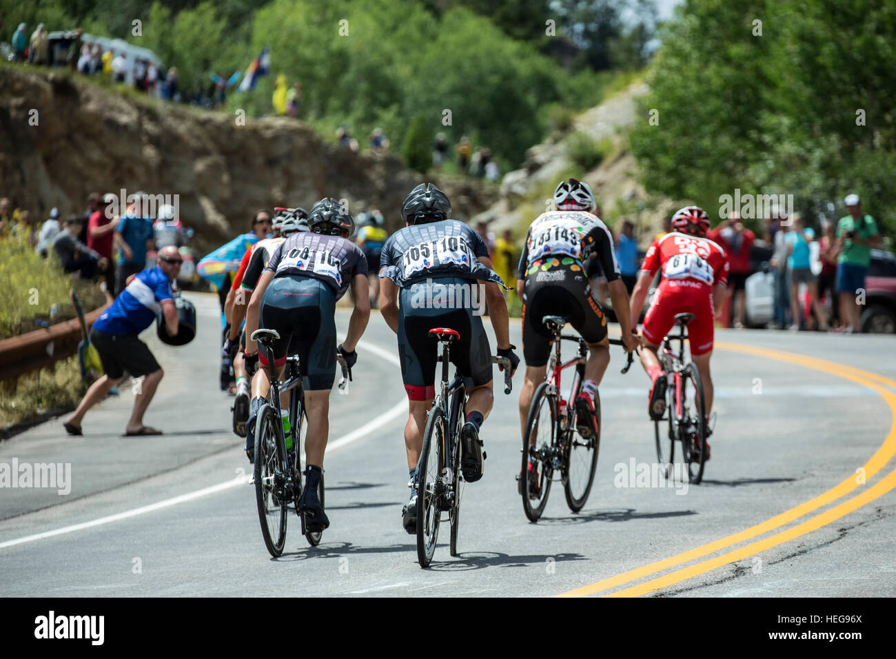 Bicycle riders riding up McClure Pass, USA Pro Challenge bicycle race, Colorado - Stock Image