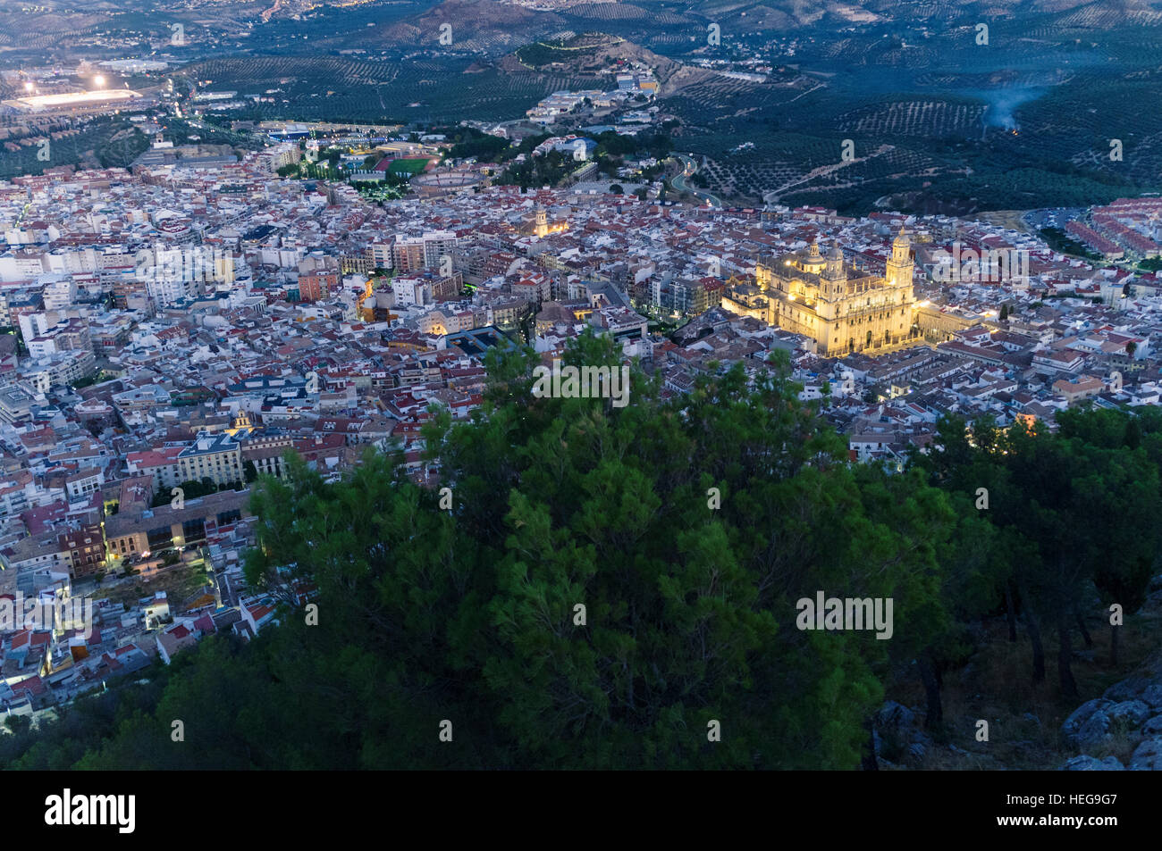 Jaen city overview at dusk with illuminated cathedral. Jaén, Andalusia, Spain - Stock Image