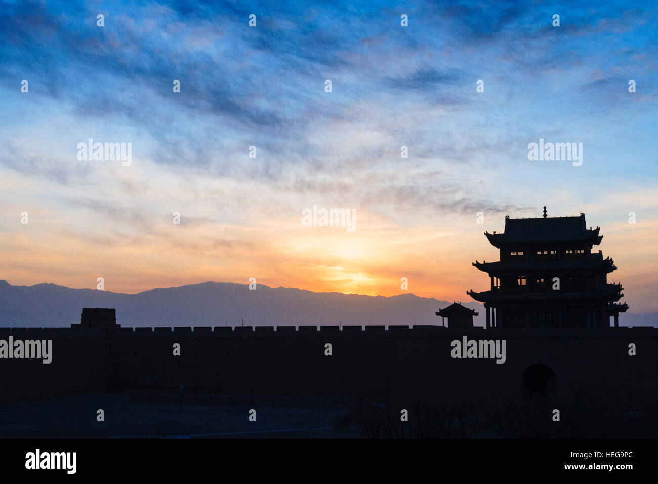 Jiayuguan fort at dusk at the western boundary of the Great Wall of China, Gansu province, China, Asia The pass - Stock Image