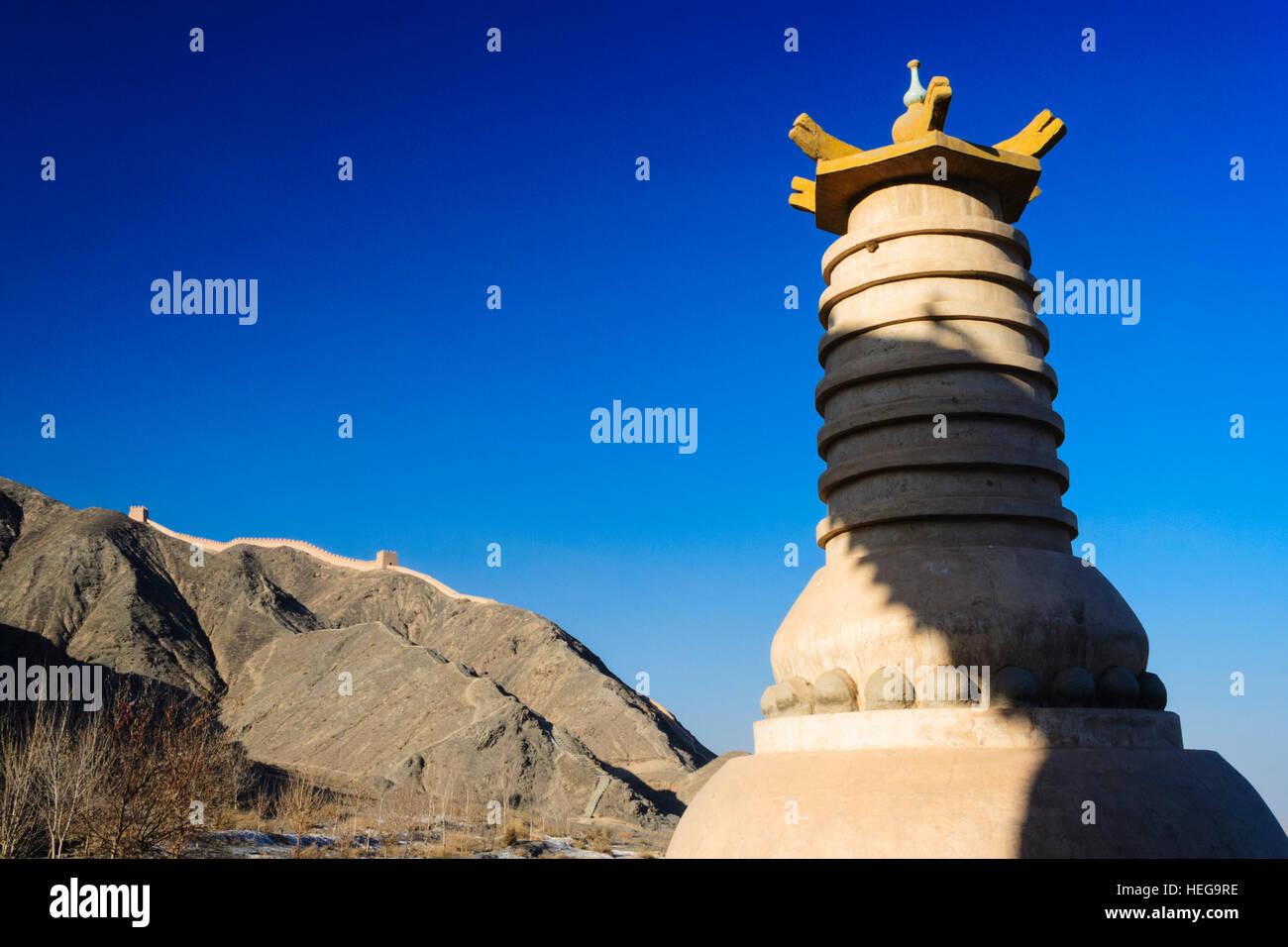 Buddhist stupa at the western confine of the Great Wall at Jiayuguan, Gansu province, China, Asia - Stock Image