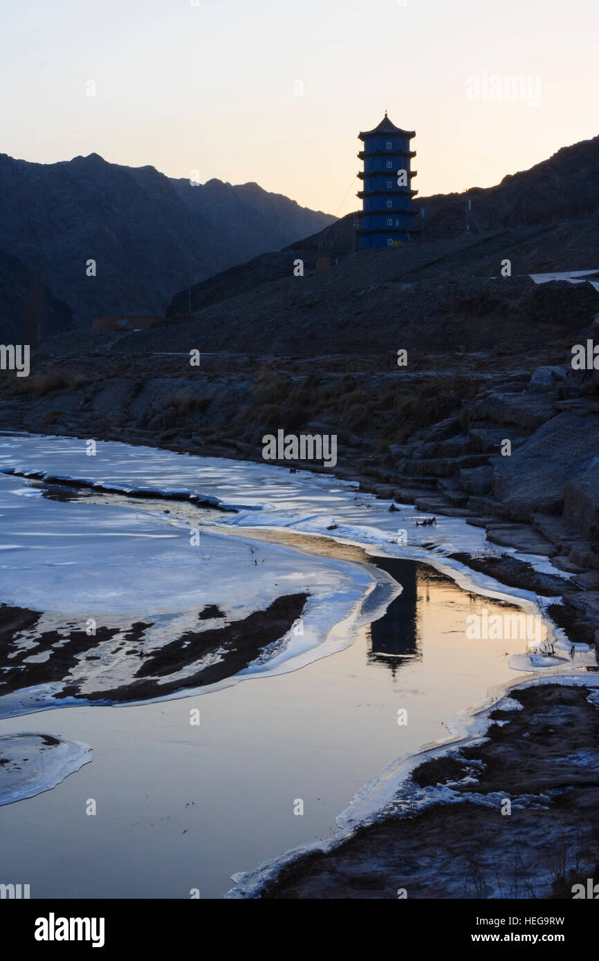 Frozen river passage known as the Hexi Corridor at the western boundary of the Great Wall at Jiayuguan, Gansu province, - Stock Image