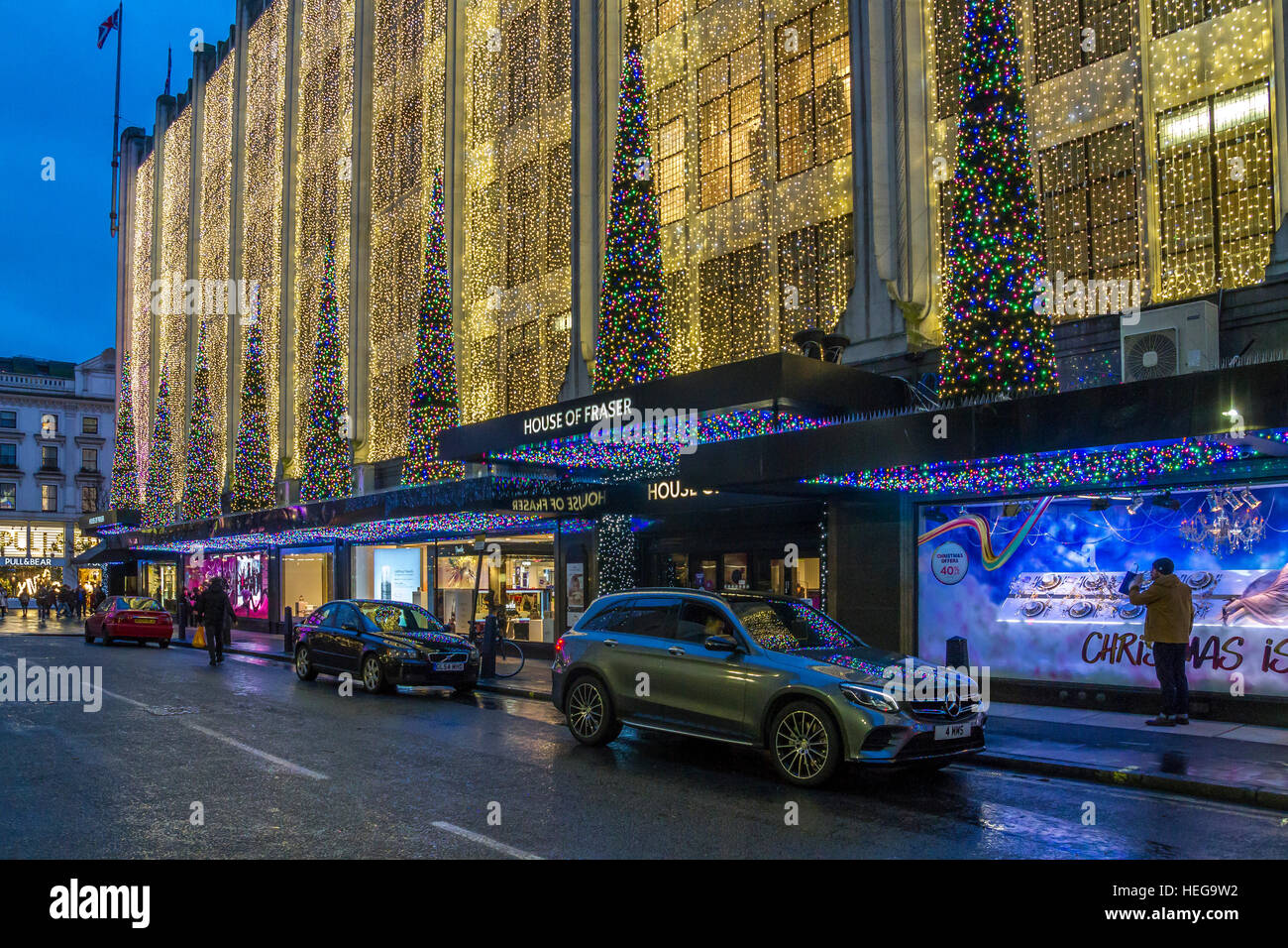 The entrance to  The House Of Fraser ,Oxford St at Christmas time Christmas Lights ,London - Stock Image
