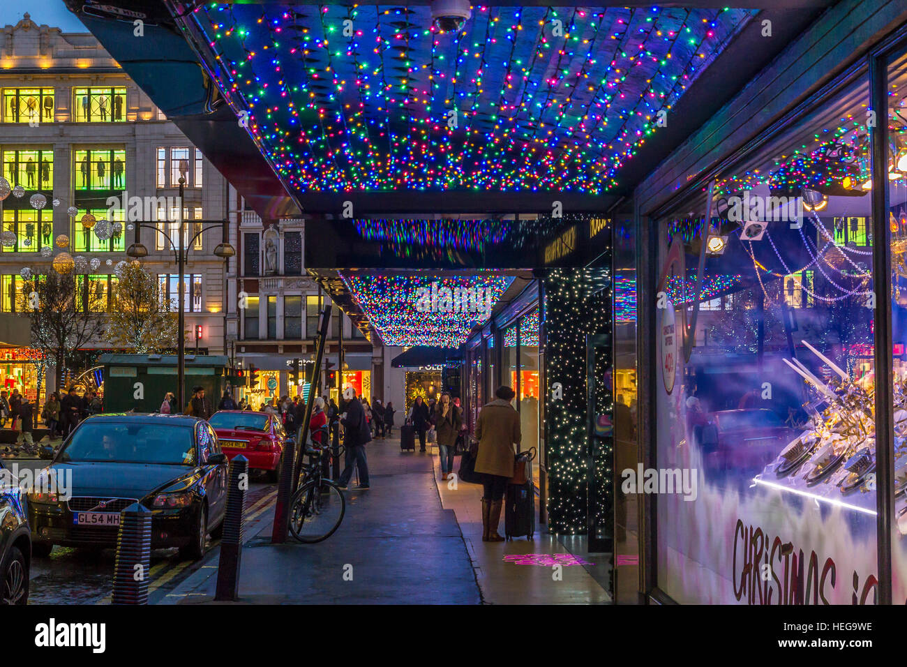 The entrance to  The House Of Fraser on London's Oxford St at Christmas time , The shop all decked out in Christmas - Stock Image