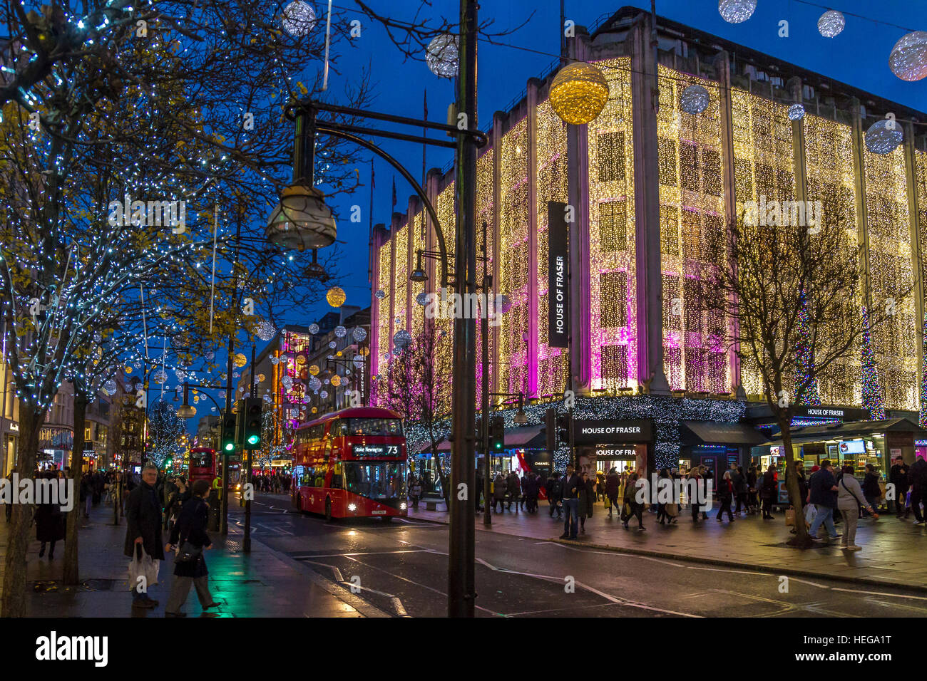 Christmas shoppers on Oxford Street with the Oxford Street  Christmas Lights  ,London - Stock Image