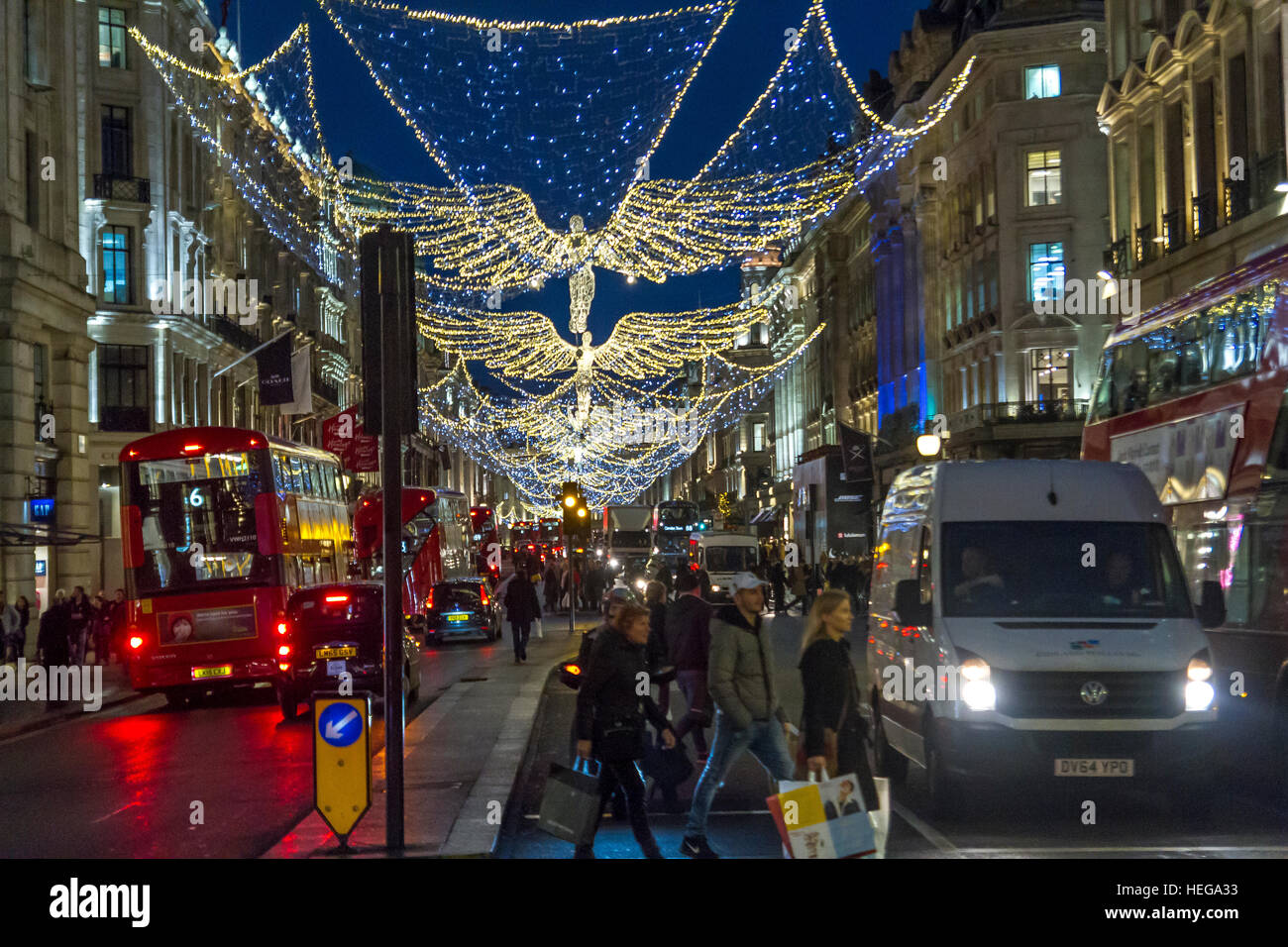 Christmas shoppers on Regent Street with the Regent Street  Christmas Lights  ,London - Stock Image