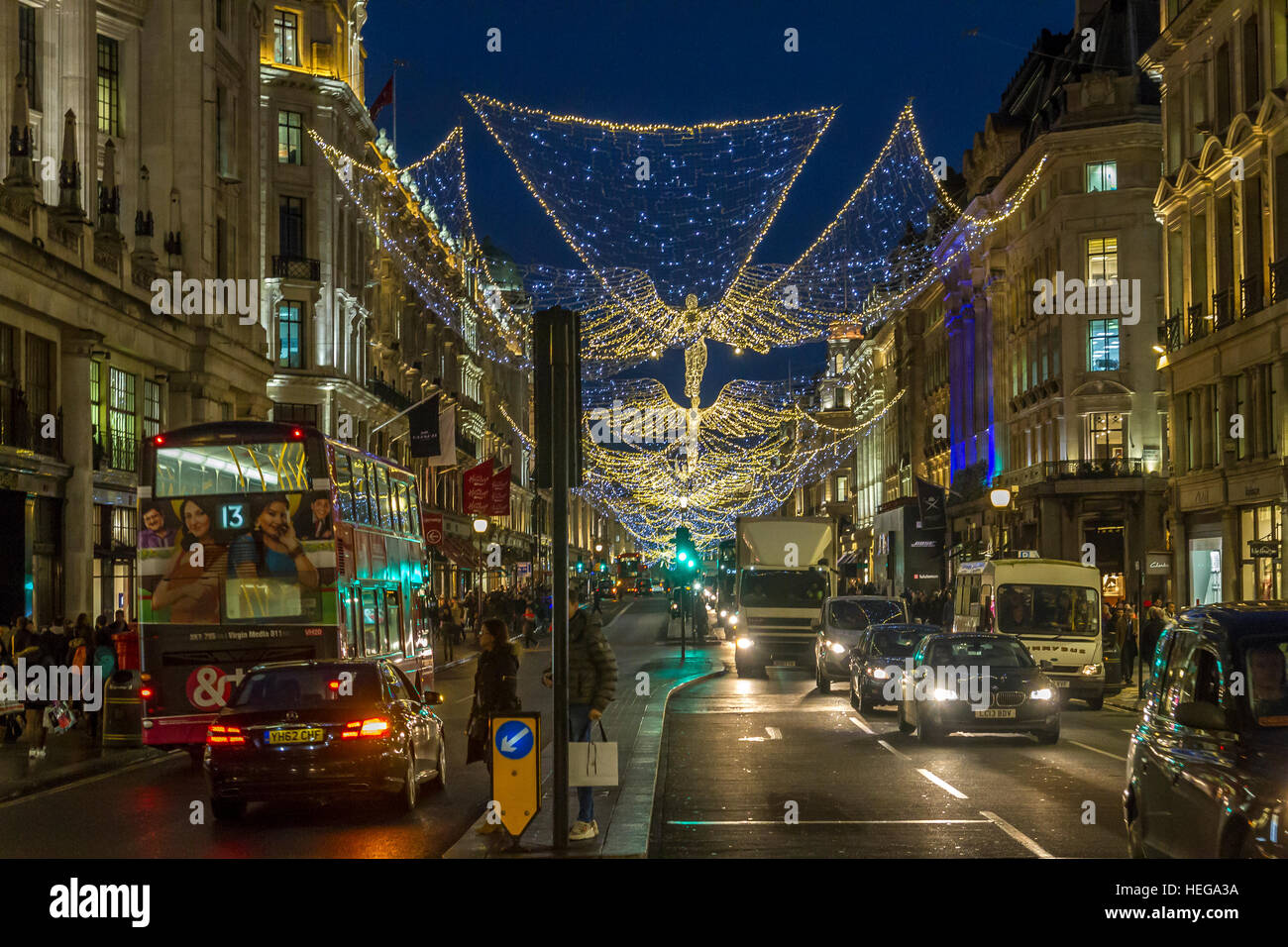 Christmas shoppers on Regent Street with the Regent Street  Christmas Lights  ,London Stock Photo