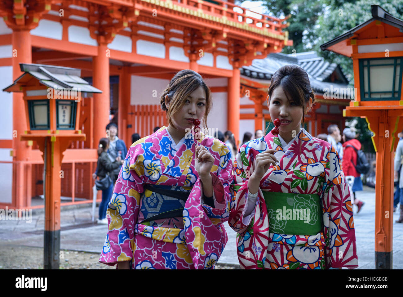 Girls with lollipops, Kyoto, Japan - Stock Image