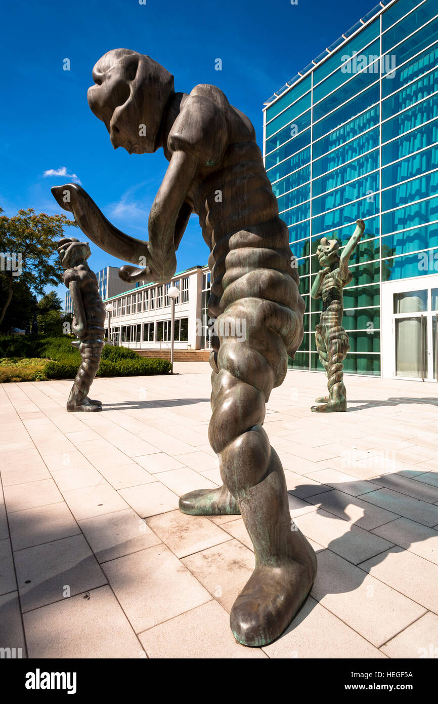 Germany, Essen, bronze sculptures  in front of the glas foyer of the Philharmonie, Saalbau. Stock Photo