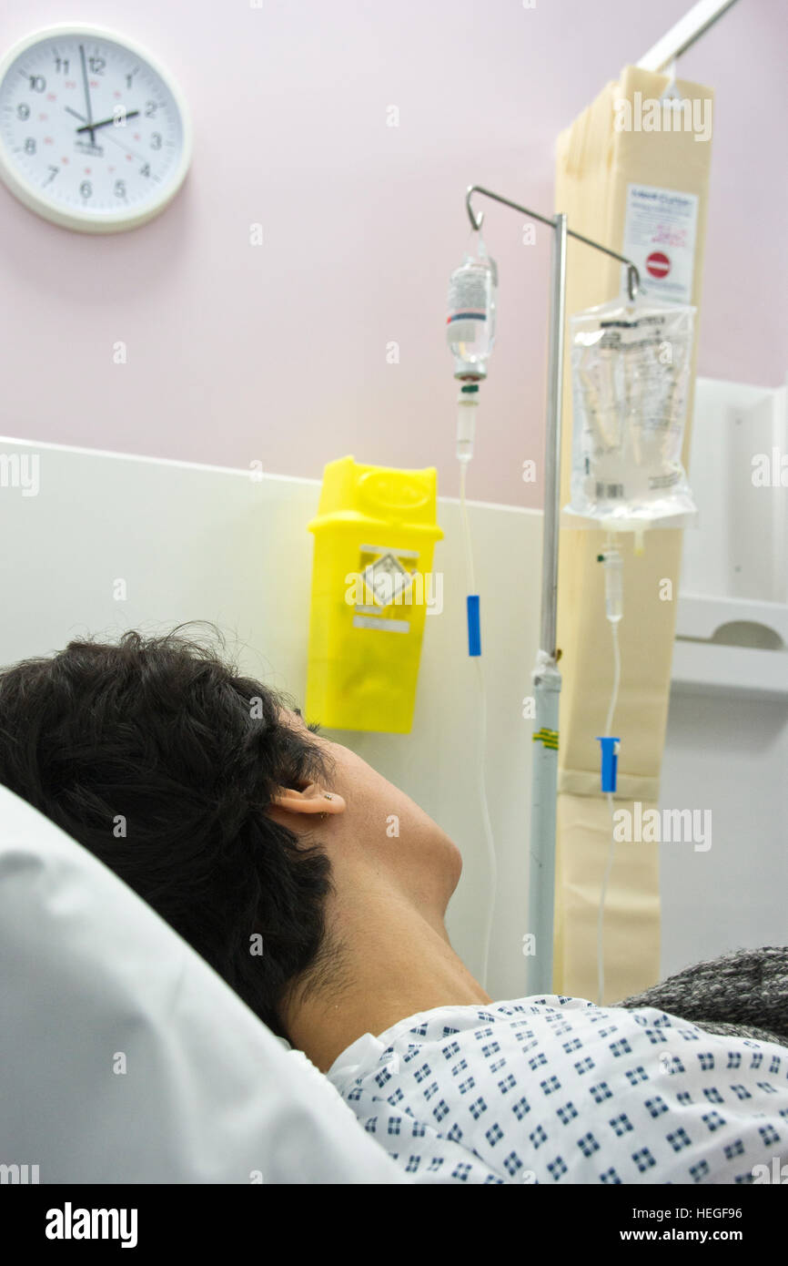 Female patient in her 40`s given transfusion and painkiller Stock Photo