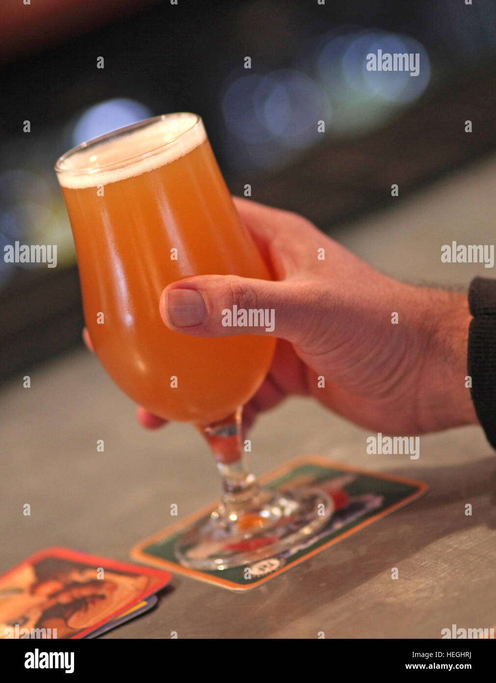 Hand holding a craft beer Stock Photo