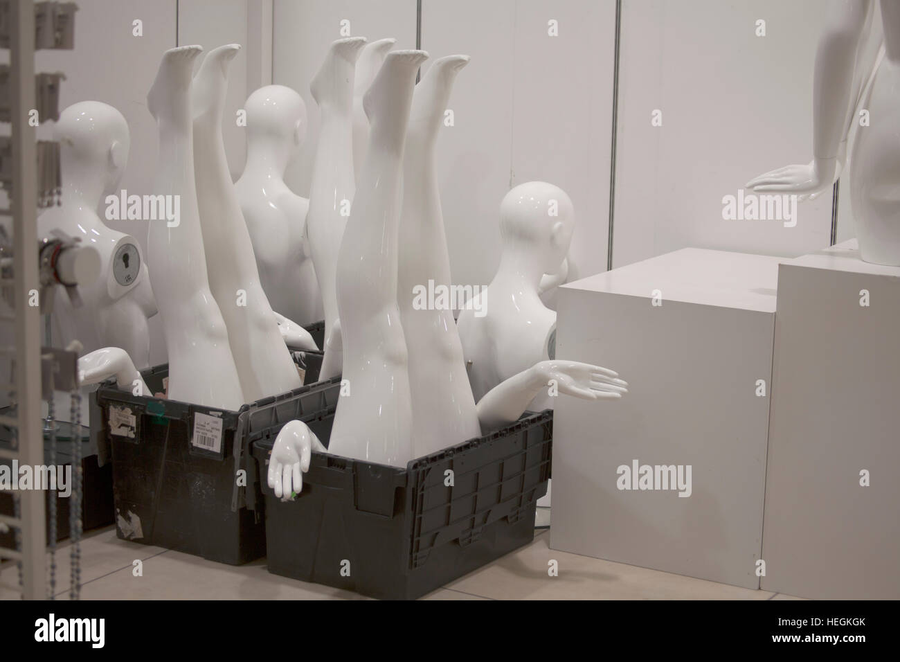 mannequin,upside down,taken apart, packed away, closing down, in box, legs sticking up, stashed away, hands out,in - Stock Image