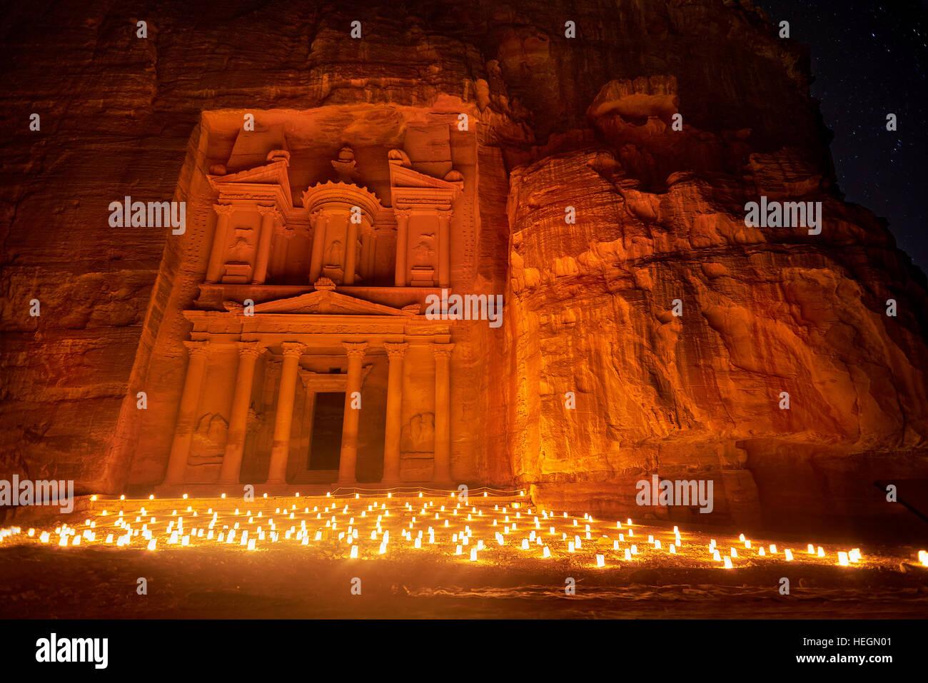 Al Khazneh - the treasury, ancient city of Petra by night, Jordan - Stock Image