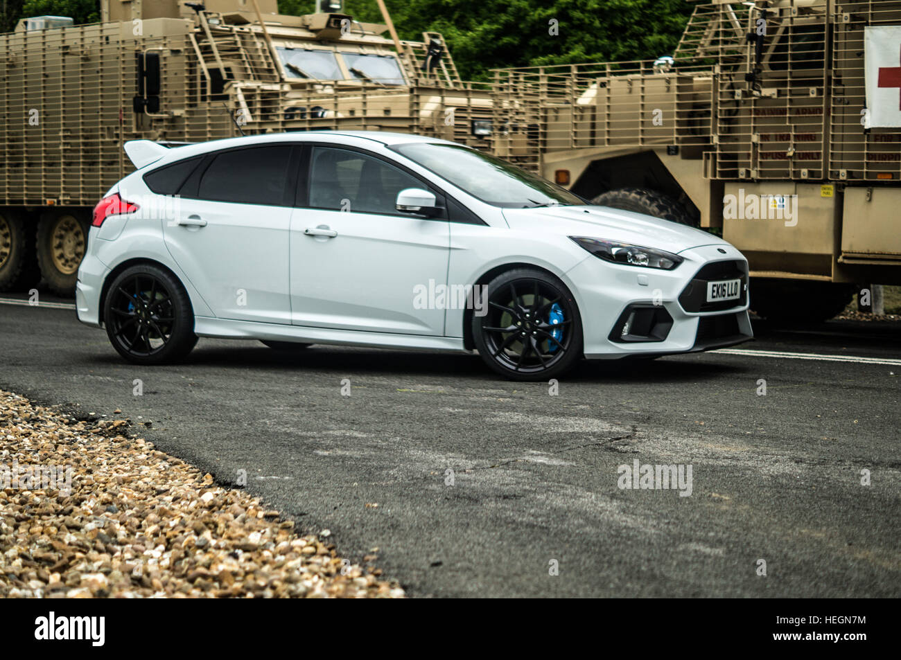 White Mark  Mkiv Ford Focus Rs Parked In Front Of Army Military Equipment