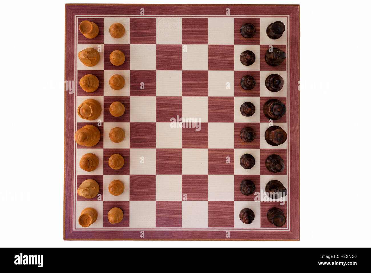 boxwood chessboard with all pieces on white background - Stock Image