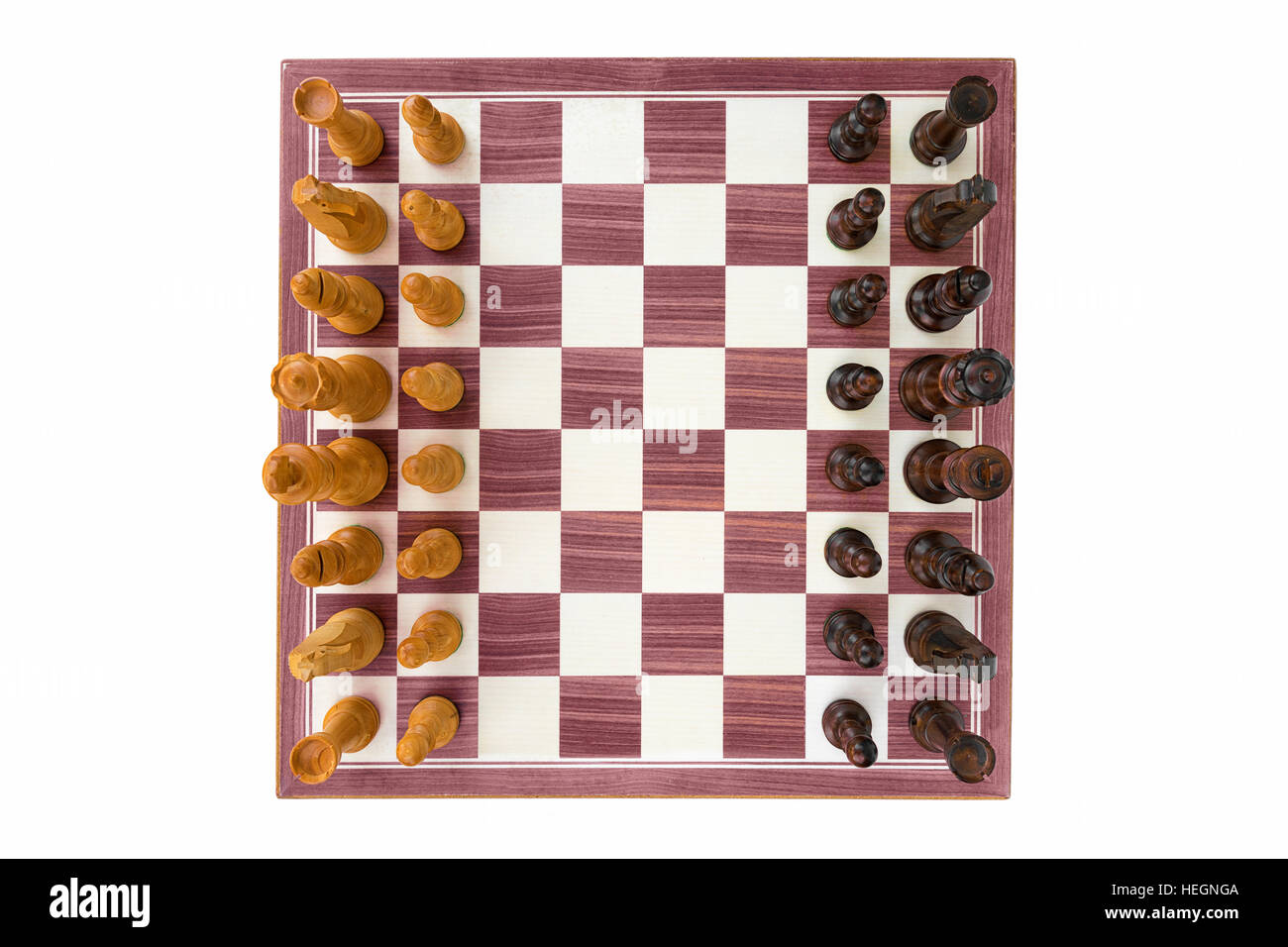 boxwood chessboard with all pieces on white background wide angle shot - Stock Image