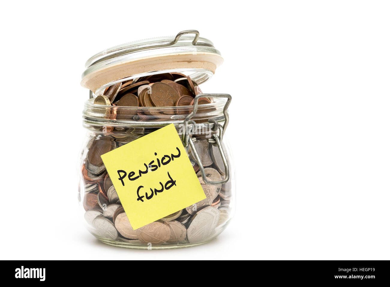 Jar of British coins collected for a pension - isolated on white background - Stock Image