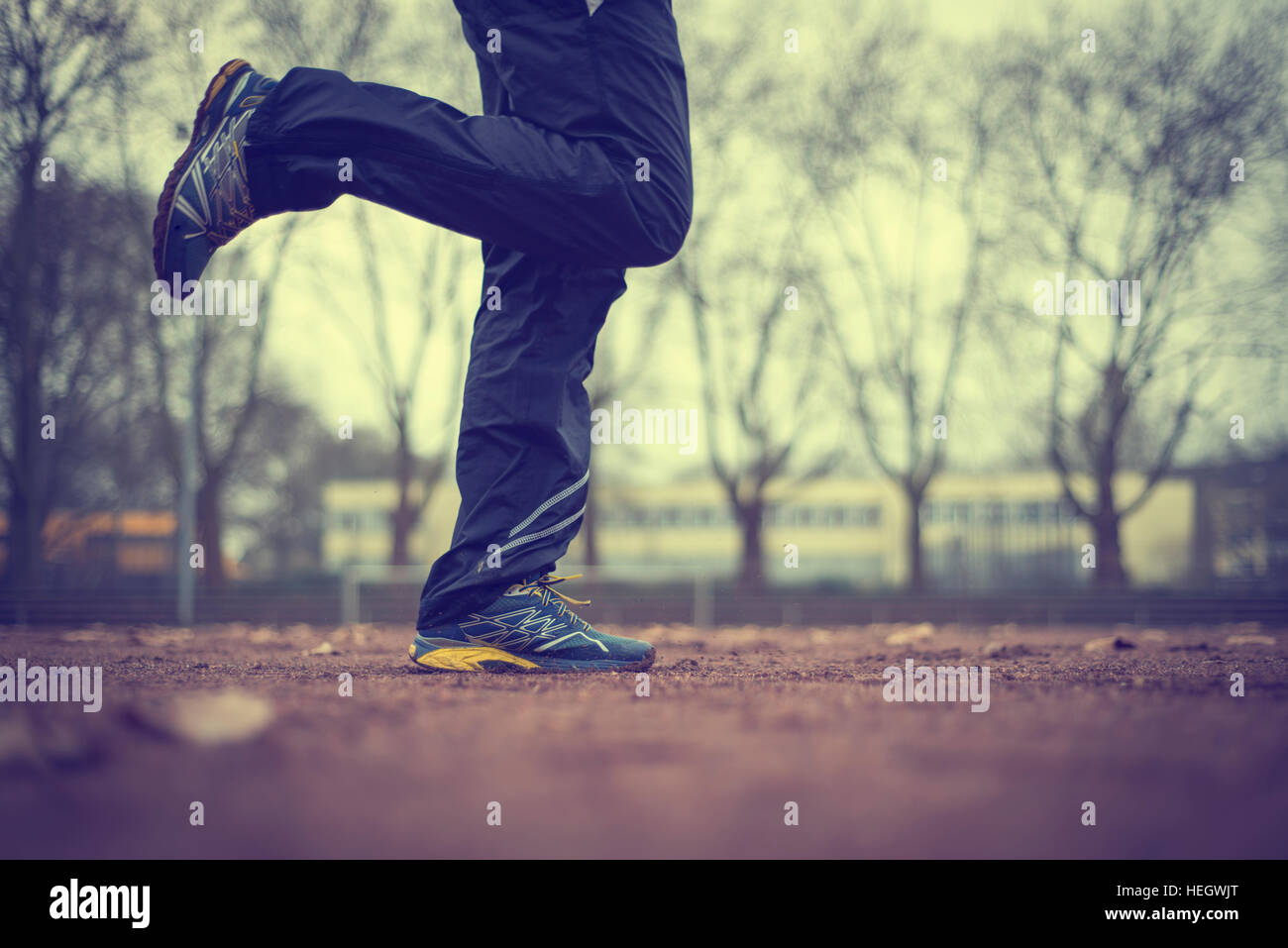 Early morning run-jogging on the stadion-sport field. - Stock Image