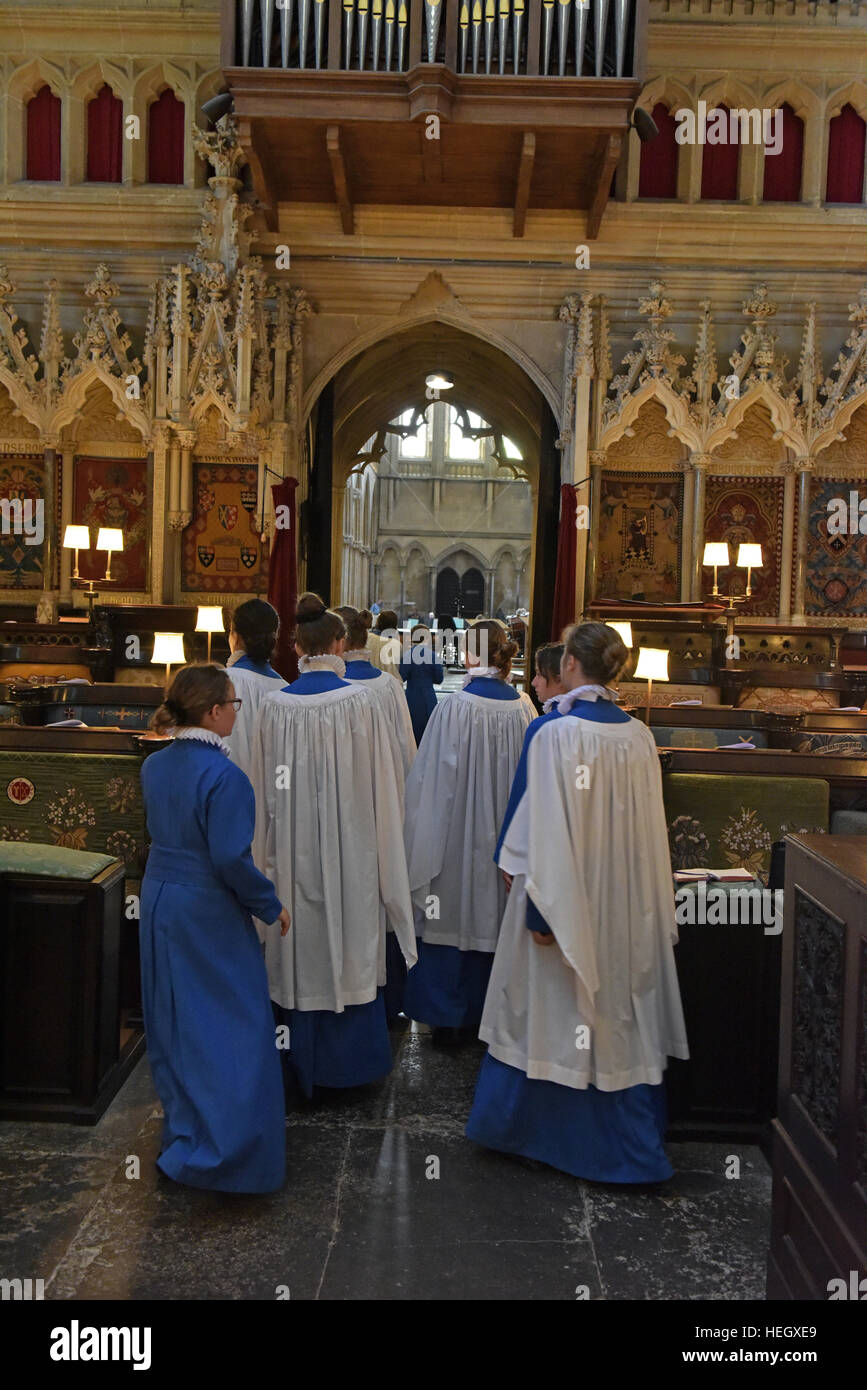 Girl choristers from Wells Cathedral Choir rehearse for evensong chorister duty in the quire at Wells Cathedral. Stock Photo