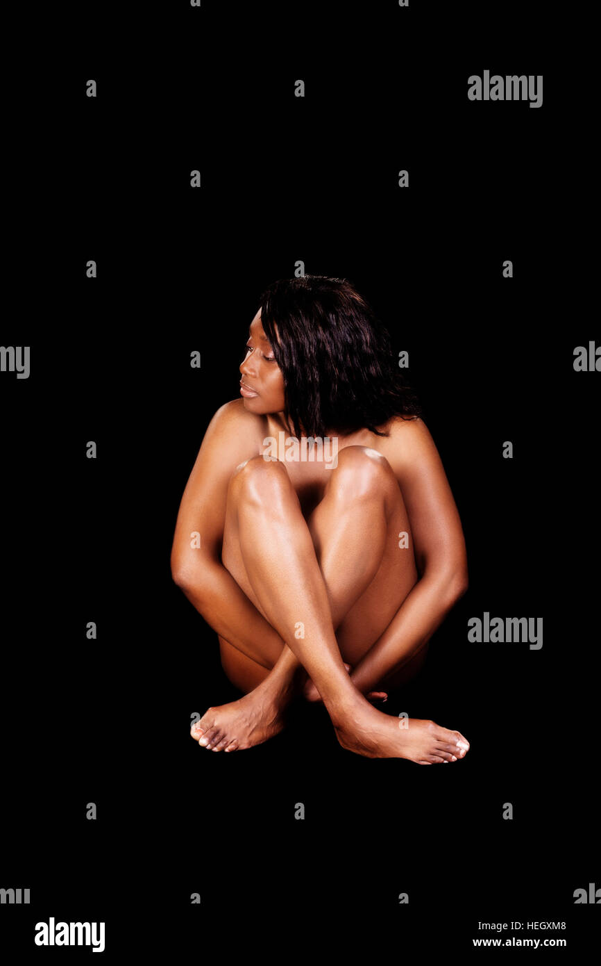 Bare African American Woman Sitting With Legs Covering Breasts Implied Nude Stock Photo
