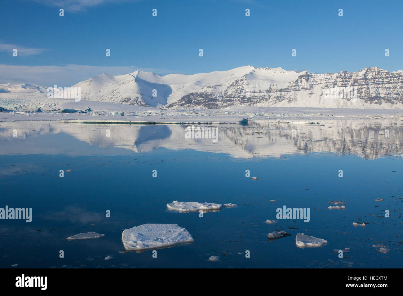 Drift ice floating in Jökulsárlón glacier lagoon in winter, glacial lake in southeast Iceland - Stock Image