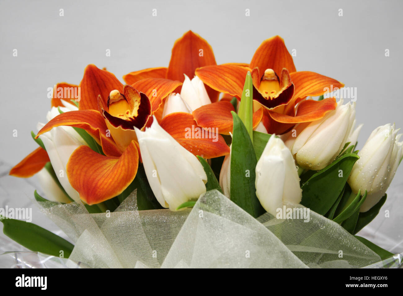 Wedding Bouquet In Spring Time Orange Orchids And White Crocuses