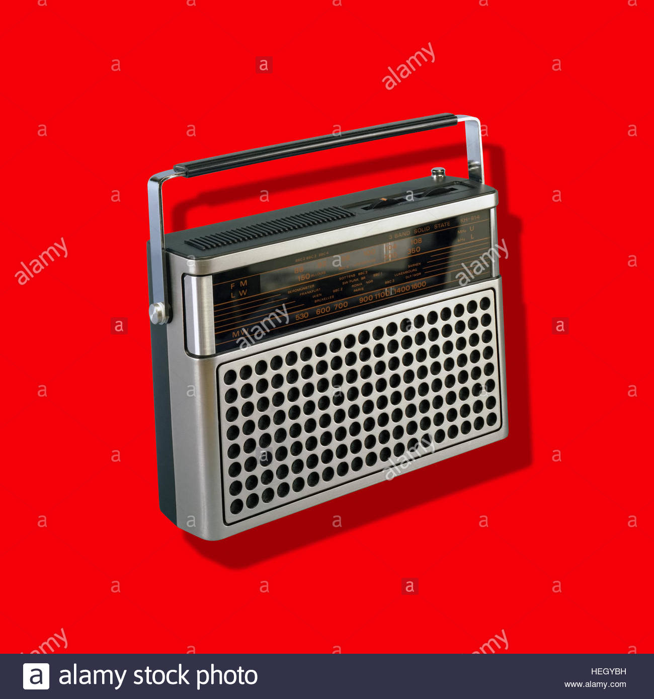 Portable Radio Vintage Music Player kitsch retro hand held isolated mid century  on plain background - Stock Image